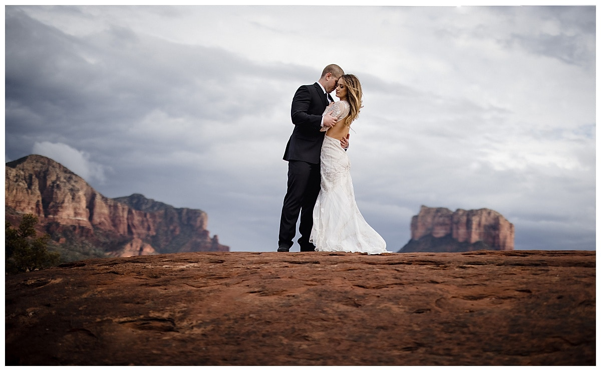 cathedral rock bride and groom, groom holding bride in sedona elopement