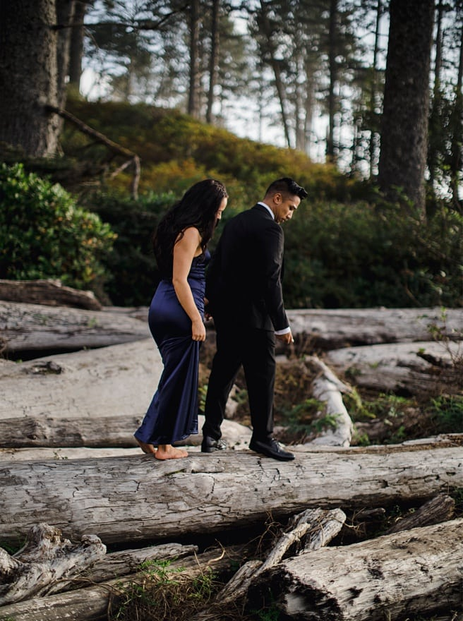 Couple balancing on drift wood for their Ruby Beach Engagement Photoshoot