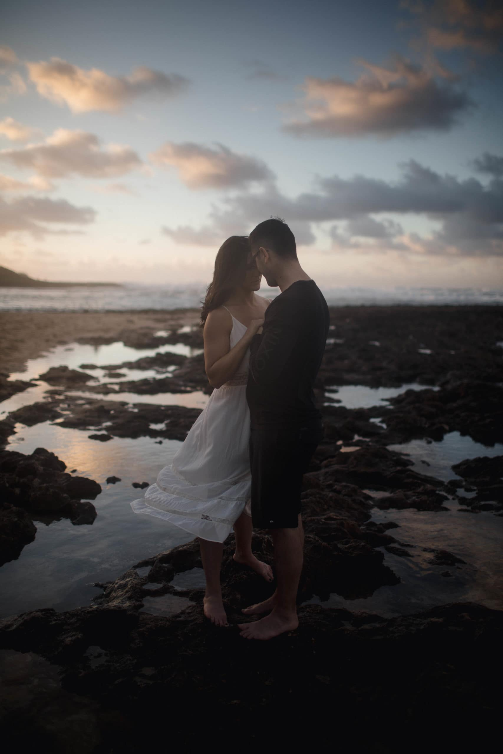 Couple on the beach in Hawaii posing for their California elopement photographer.