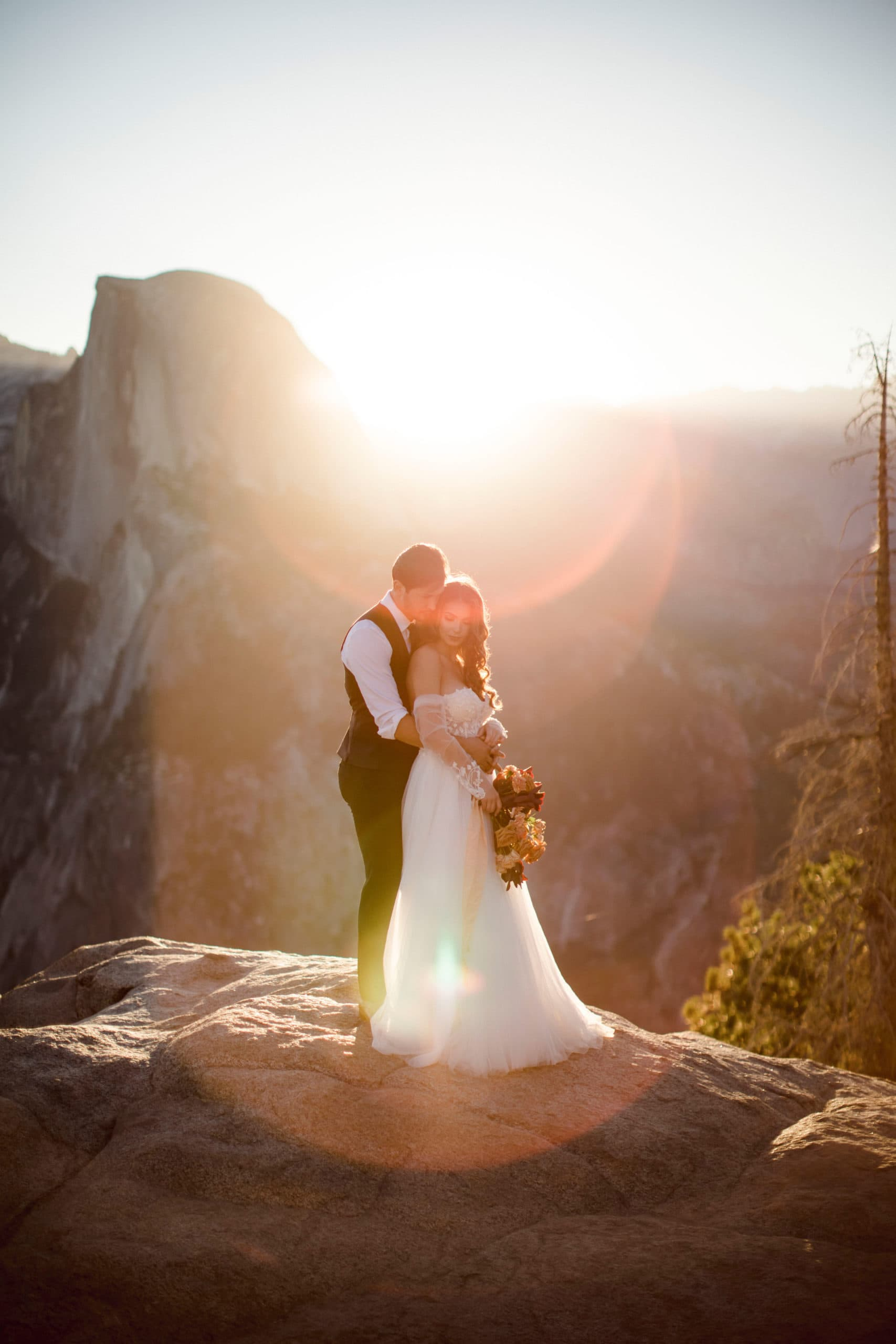 A couple at their Yosemite Elopement at Glacier point.