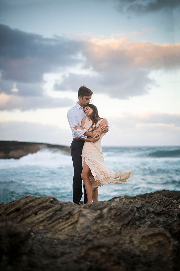 couple by the sea in Hawaii at their elopement.