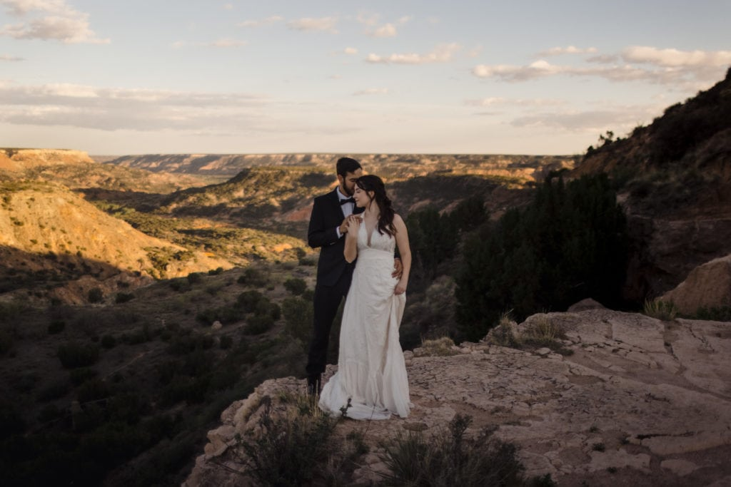 Couple in Palo Duro Canyon Eloping on edge of cliff.