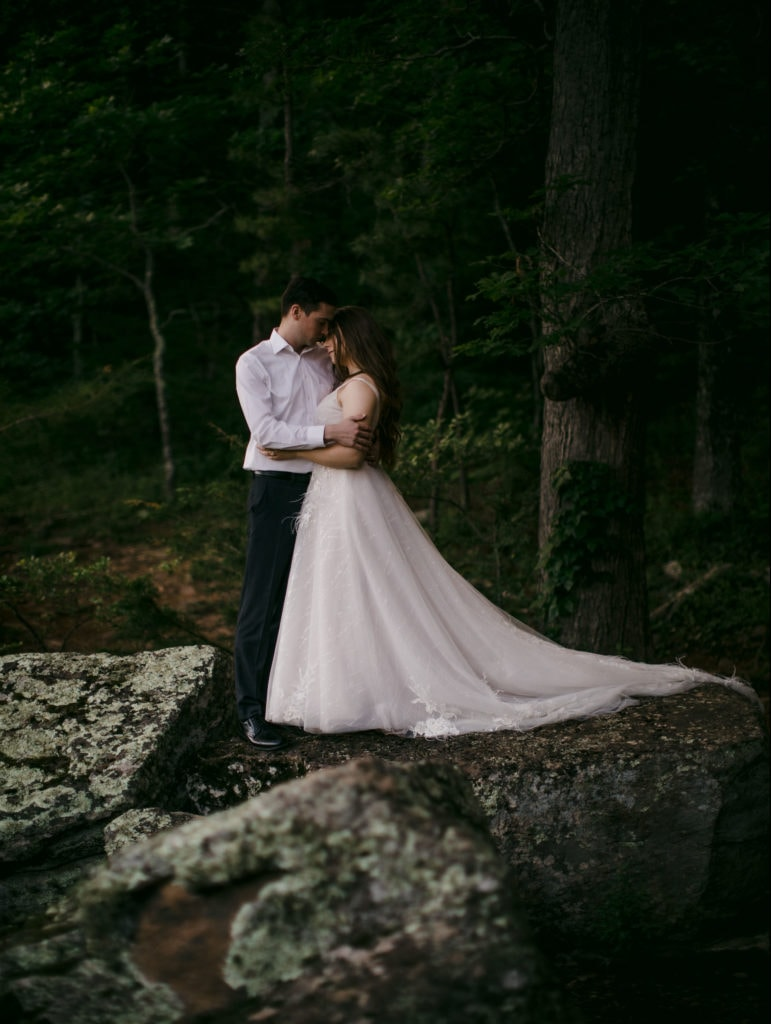 Married couple embracing after their vow renewal in Yosemite National Park.