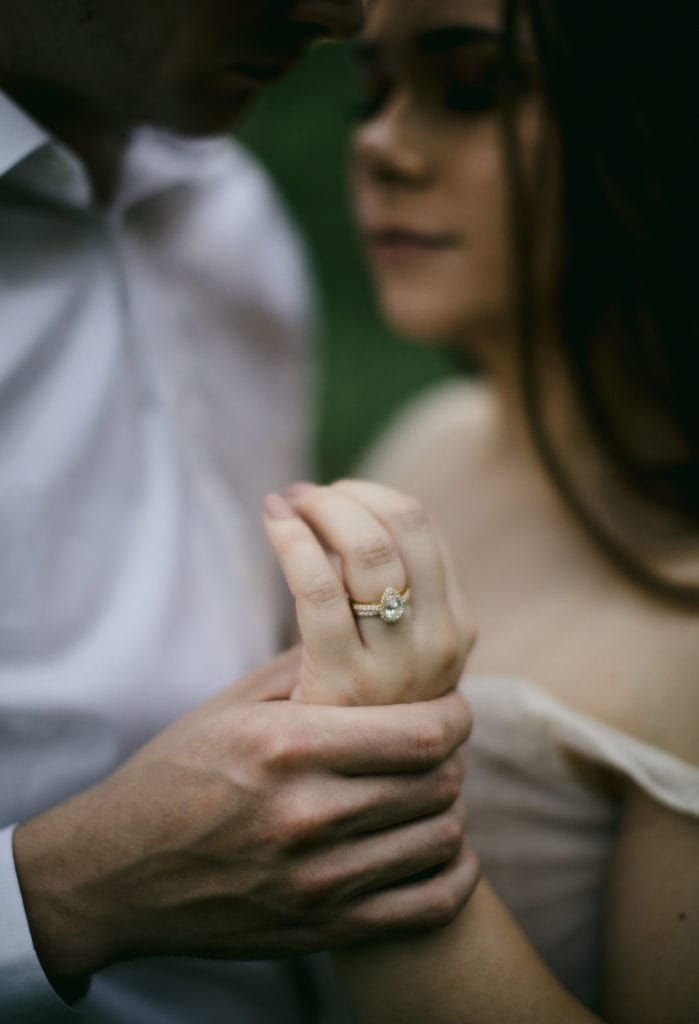 Couple in the forest embracing after their vow renewal ceremony.