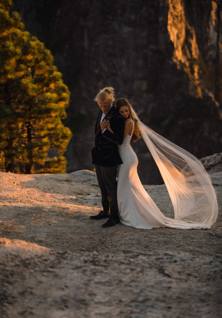 A bride eloping at Taft Point that had to fly with a wedding dress.