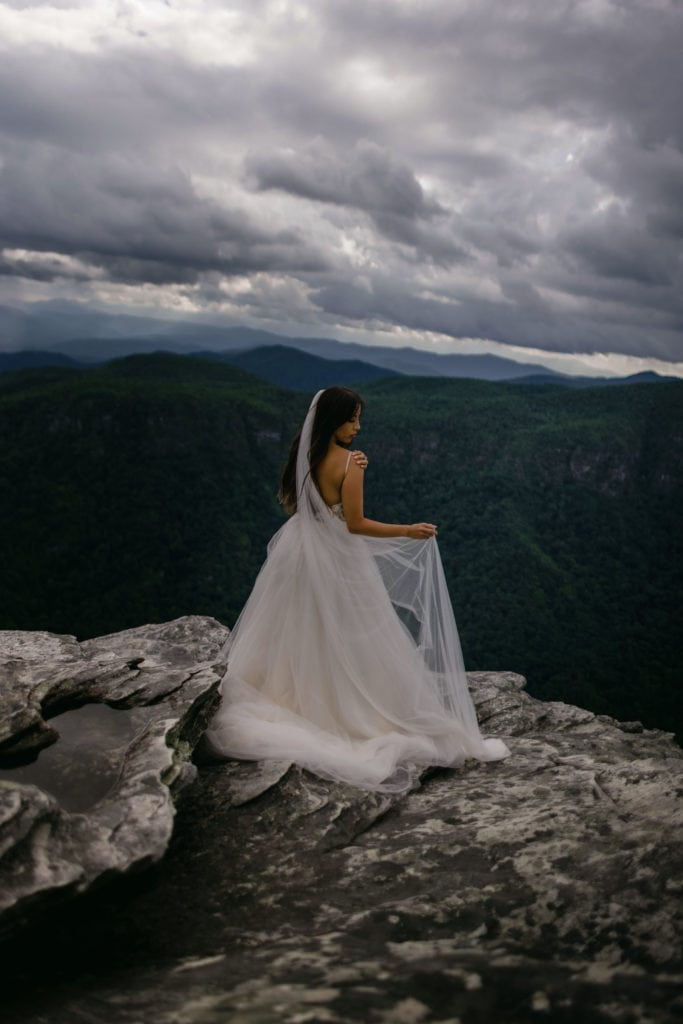 A bride in her adventure elopement photography in Asheville.