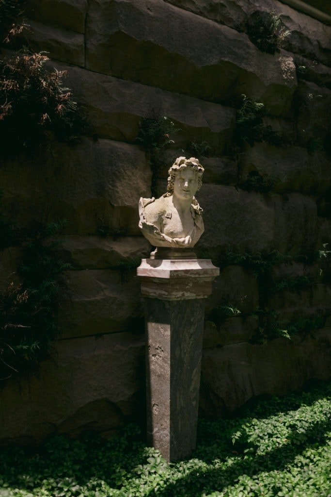 One of the many statues and busts located within the gardens at the Biltmore Estate.