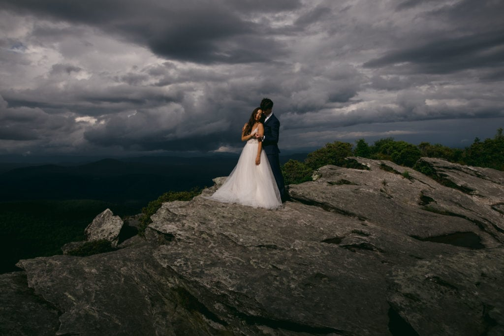 A couple in their adventure elopement photography in Asheville.