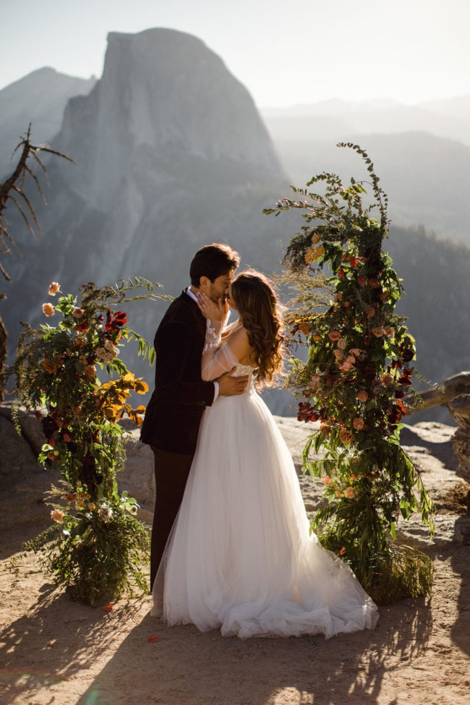 A couple sharing their first kiss that decided to elope in Yosemite.