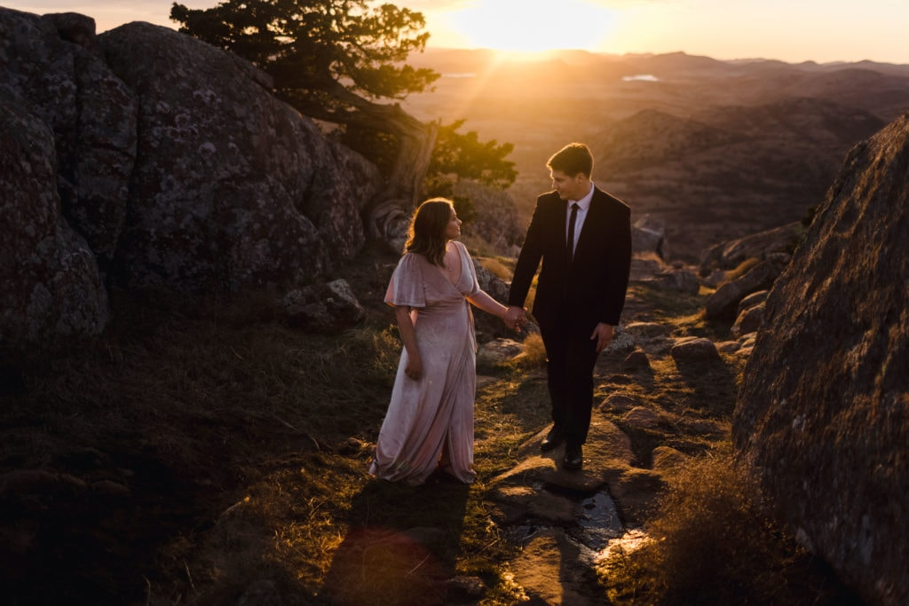 Arik and Emily being on the side of a mountain with the best elopement photographer.