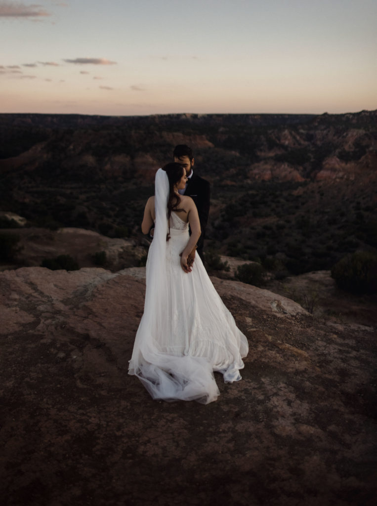 A couple in their wedding elopement photography in a canyon.