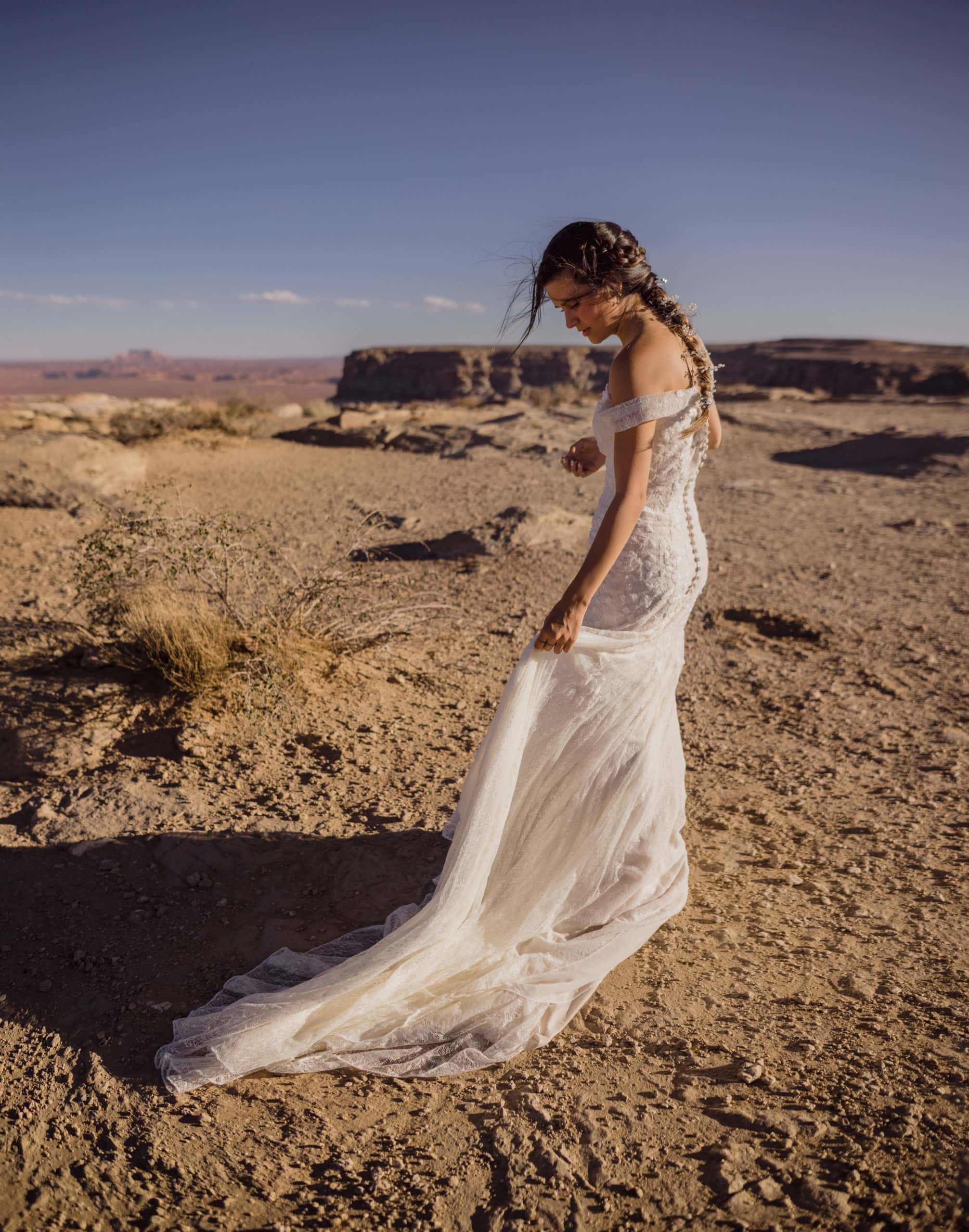 A bride after her wedding in elopement pictures at Lake Powell.